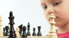 Ambitious little chess player. Small genius. Stock Footage