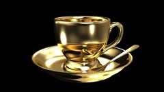 Gold teacup - stock footage