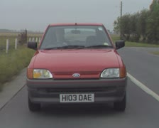 Frontal view of red car driving Stock Footage