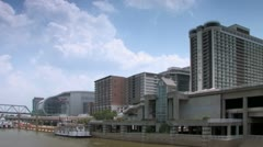 Stock Video Footage of Louisville Kentucky downtown skyline along Riverfront Park seen from Ohio River