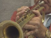 Stock Video Footage of Close up of trumpet player in the street