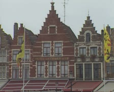 Panning view of hotel and traditional buildings fronts Stock Footage