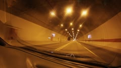 Car driving through the tunnel tube Stock Footage