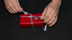 Open present with iPhone Stock Footage