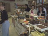 Shot of interior of chocolate shop from behind counter Stock Footage