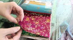 Various Chinese cloth designs for curtains available in a shop. Stock Footage