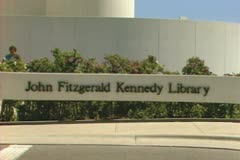 Zoom out from John Fitzgerald Kennedy Library sign to entire building Stock Footage