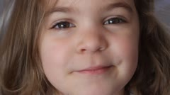 Little girl pulling a face Stock Footage