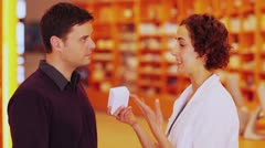Pharmacist talking to customer Stock Footage