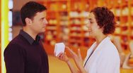 Stock Video Footage of pharmacist talking to customer