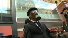 Protest, Occupy (Wall-Street) Calgary #23, gas mask man Stock Footage
