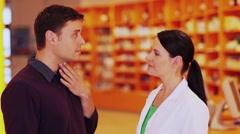 Pharmacist listening to customer Stock Footage