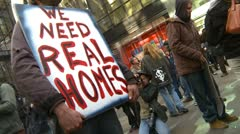Protest, Occupy (Wall-Street) Calgary #36, we need real homes signs - stock footage