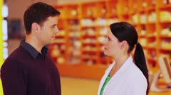 pharmacist talking to buyer - stock footage