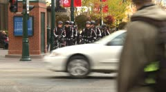 Crime and justice, police on bikes with traffic in foreground Stock Footage