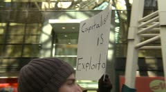 Protest, Occupy (Wall-Street) Calgary #24, greed is an act of violence signs - stock footage