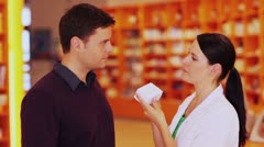 Stock Video Footage of customer listening to pharmacist