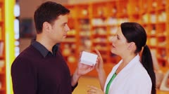 man buying medicine in pharmacy - stock footage