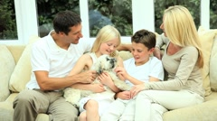 Caucasian Family Petting their Dog Stock Footage