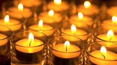 In memoriam.  Remembrance candles flickering - Lit for the departed. Stock Footage