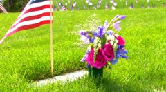 Memorial Flag & Flowers at National Cemetery Stock Footage