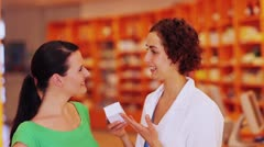 Stock Video Footage of woman buying medicine from pharmacist