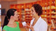Woman buying medicine from pharmacist Stock Footage