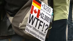 Protest, Occupy (Wall-Street) Calgary #38, WTF signs Stock Footage