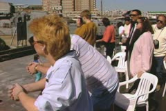 Tour group standing on tour boat looking into Boston Navy Yard Stock Footage