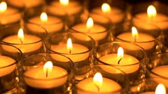 In memoriam.  Remembrance candles flickering - Lit for the departed. Shallow DOF Stock Footage