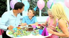 Attractive Caucasian Family Enjoying Birthday Cake - stock footage