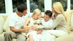 Young Caucasian Family with Pet Dog Stock Footage