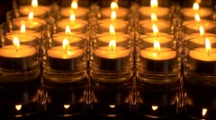 In memoriam.  Remembrance candles flickering - Pull focus to soft light Stock Footage