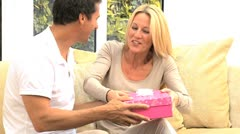Caucasian Female Receiving Birthday Gift from Husband Stock Footage