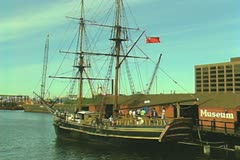 Historical style Boston Tea Party tour ship next to museum Stock Footage