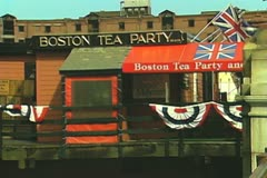 Zoom out from Boston Tea Party museum and ship Stock Footage