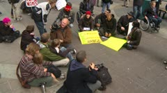 Protest, Occupy (Wall-Street) Calgary #46, sit down and pan,  - stock footage