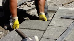 Timelapse Construction worker laying cobble stone pavement Stock Footage