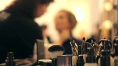 Professional makeup artist putting cosmetics. Focus on the instrument. - stock footage