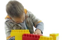 Happy little boy playing with color blocks.  Stock Footage