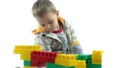 Joyful little boy playing with color blocks. Happy child. Stock Footage