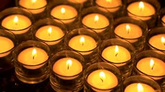 In memoriam.  Remembrance candles flickering - slight angle. Shallow DOF Stock Footage