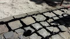 Construction asphalt between cobbles stone pavement Stock Footage