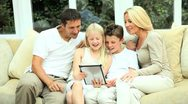 Stock Video Footage of Caucasian Family Using Online Video Chat with Relatives