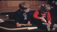 Girl feeding her doll (Vintage 8 mm amateur film) - stock footage