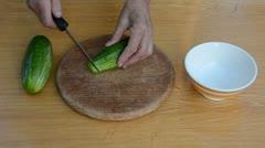0117 grandmother hands cut up green cucumber Stock Footage