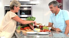 Mature Couple Preparing Healthy Lunch - stock footage