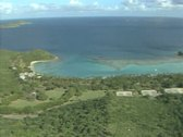Aerial view of coastal land and sea Stock Footage