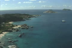 Aerial view of coast moving out over sea Stock Footage