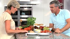 Attractive Couple Preparing Healthy Lunch Stock Footage